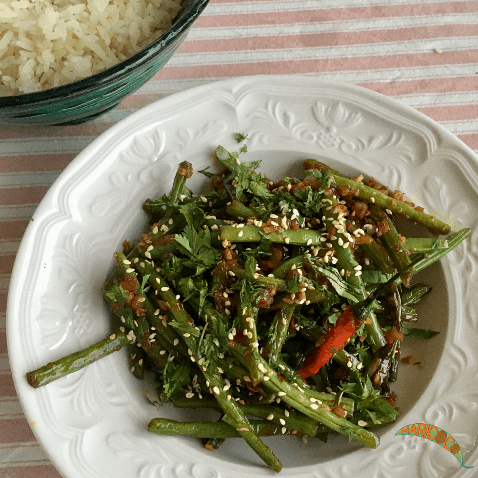 sichuan green beans on white plate